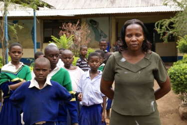 Kindergarten Kindi Amania Frau Norah Schayo